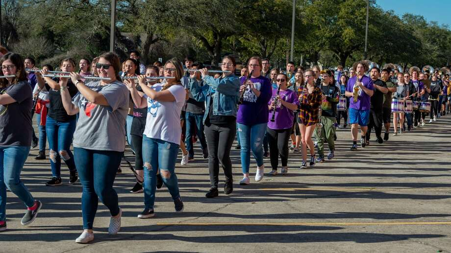 The Port Neches-Groves Indian Marching Band which is made up of students from all four concert bands, practices their performance while marching through the parking lot of the school on Thursday, March 5, 2020. The band leaves for Disney Springs on Sunday, and will be heading to Disney World to perform at the Magic Kingdom next Tuesday. Fran Ruchalski/The Enterprise Photo: Fran Ruchalski/The Enterprise