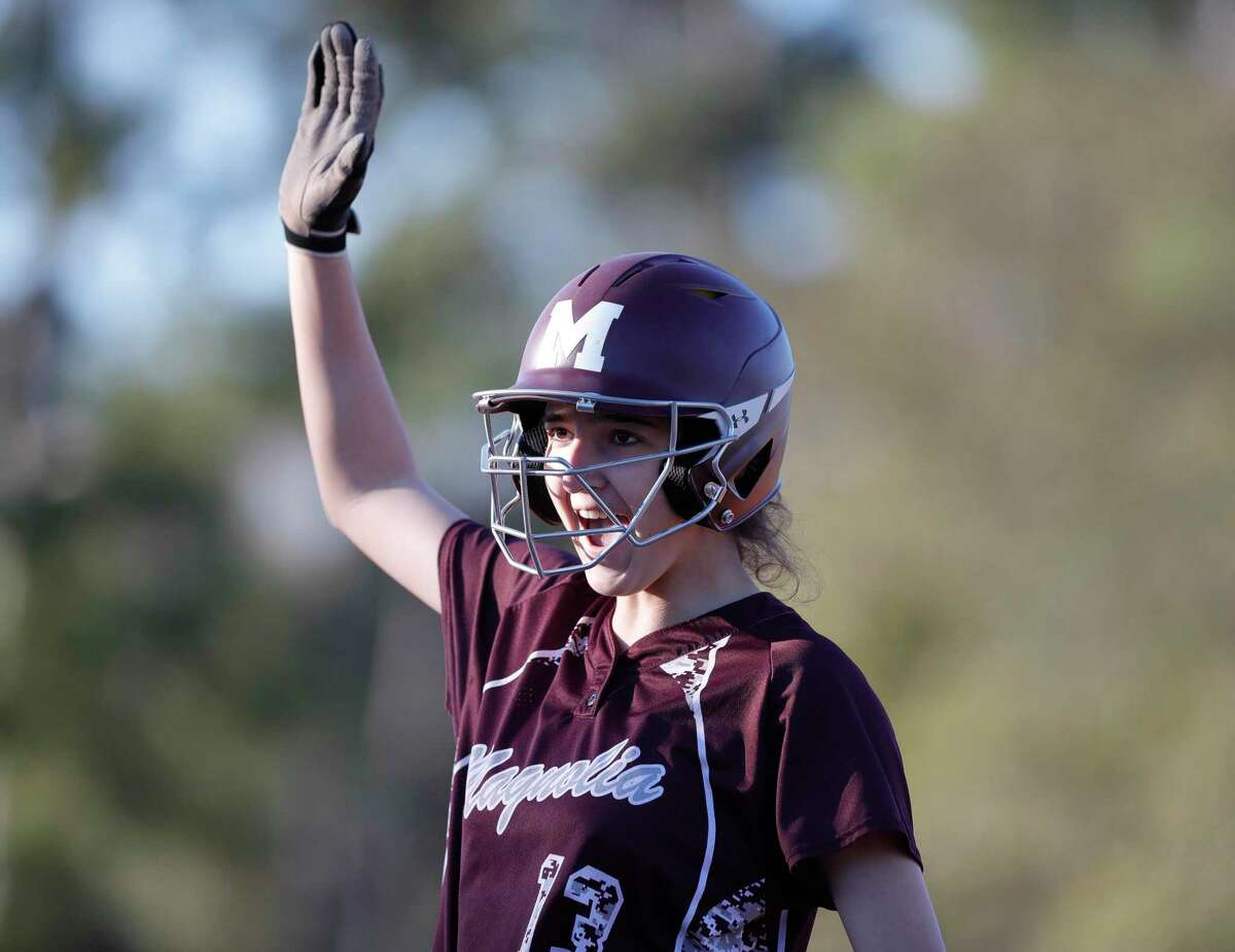 Gabrielle Huetter #13 of Magnolia reacts after hitting the game-winning RBI single to top Oak Ridge 4-3 in the sixth inning of a non-district high school softball game at Oak Ridge High School, Thursday, Feb. 27, 2020, in Oak Ridge.