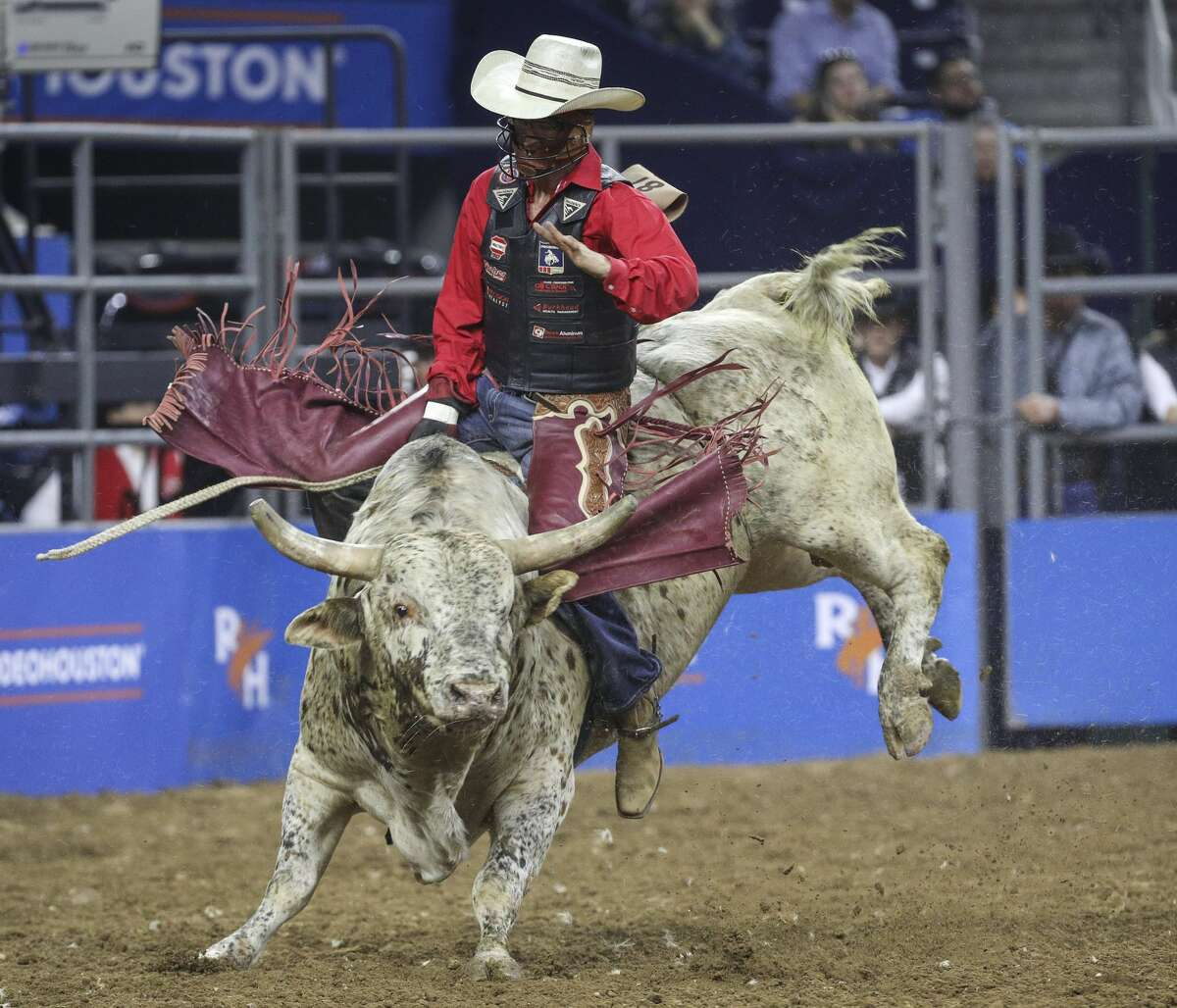 Cole Fischer competes in the bull riding event at the Houston Livestock Show and Rodeo on Thursday, March 5, 2020, at NRG Stadium in Houston.