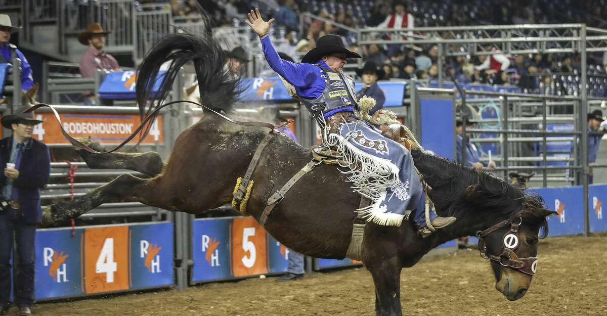 Rusty Wright competes in the saddle bronc riding event at the Houston Livestock Show and Rodeo on Thursday, March 5, 2020, at NRG Stadium in Houston.