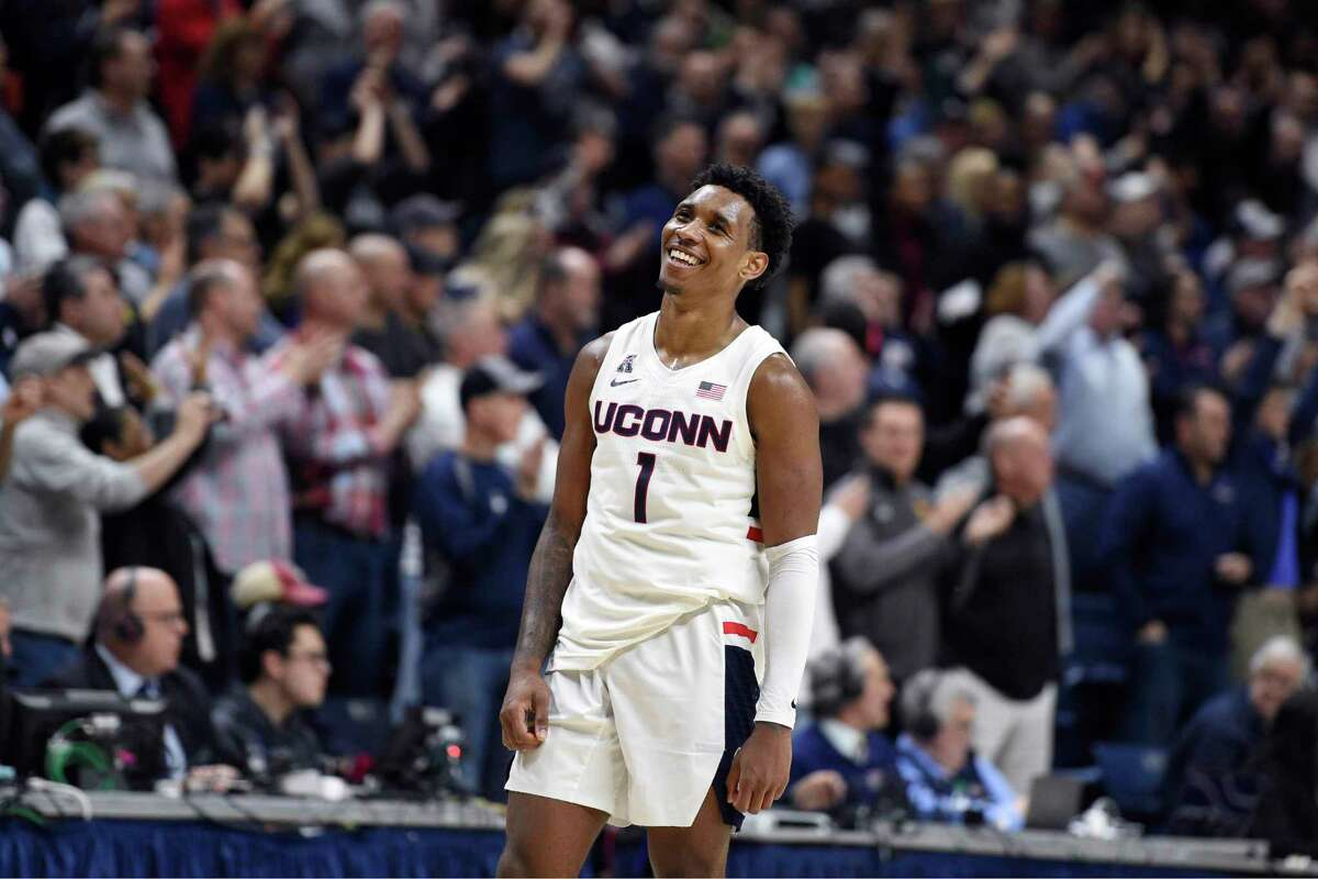 Connecticut's Christian Vital (1) smiles as the final seconds of an NCAA college basketball game against Houston wind down, Thursday, March 5, 2020, in Storrs, Conn. (AP Photo/Jessica Hill)