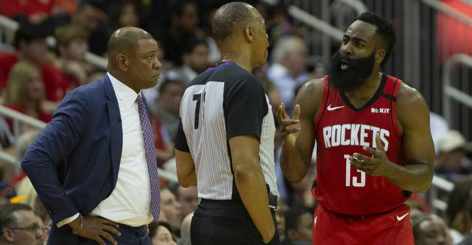 Houston Rockets guard James Harden (13) argues with referee Rodney Mott (71) during a game against the LA Clippers at the Toyota Center on Thursday, March 5, 2020, in Houston. Photo: Marie D. De Jesus/Staff Photographer