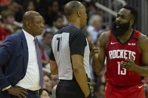 Houston Rockets guard James Harden (13) argues with referee Rodney Mott (71) during a game against the LA Clippers at the Toyota Center on Thursday, March 5, 2020, in Houston.