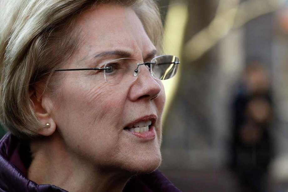 Warren Photo: Steven Senne /Associated Press / Copyright 2020 The Associated Press. All Rights Reserved