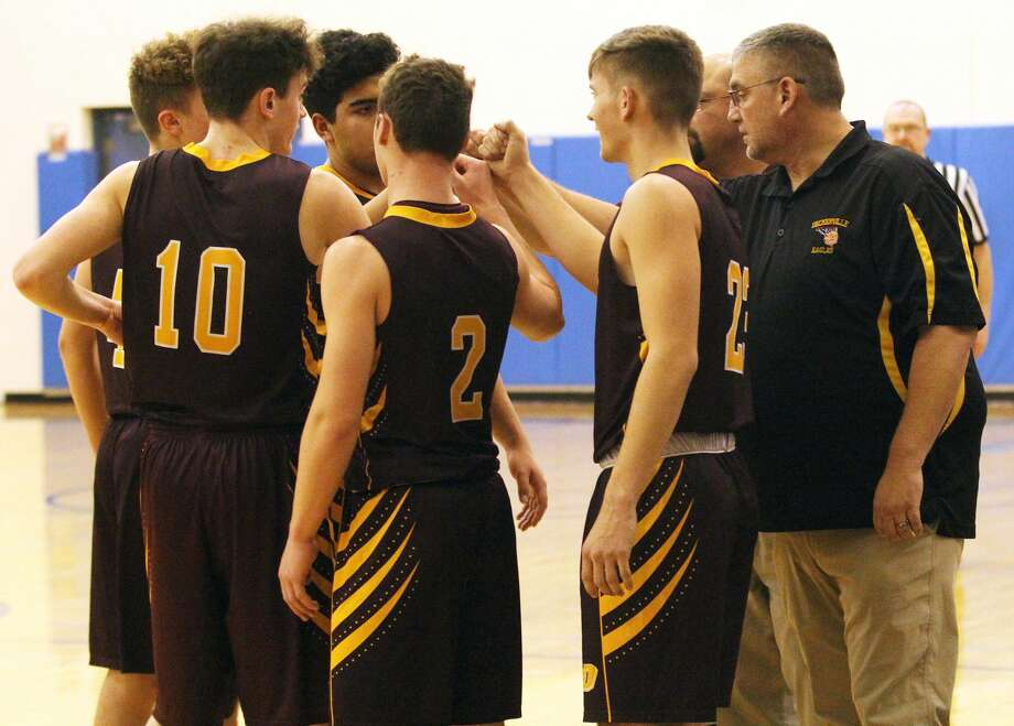 The Deckerville boys basketball team battled host North Huron for a 94-85 overtime win on Thursday night. Photo: Mark Birdsall/Huron Daily Tribune
