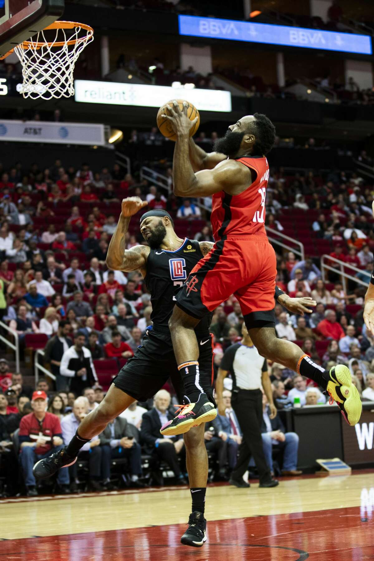 Houston Rockets guard James Harden (13) drives to the basket against LA Clippers forward Marcus Morris Sr. (31) at the Toyota Center on Thursday, March 5, 2020, in Houston.