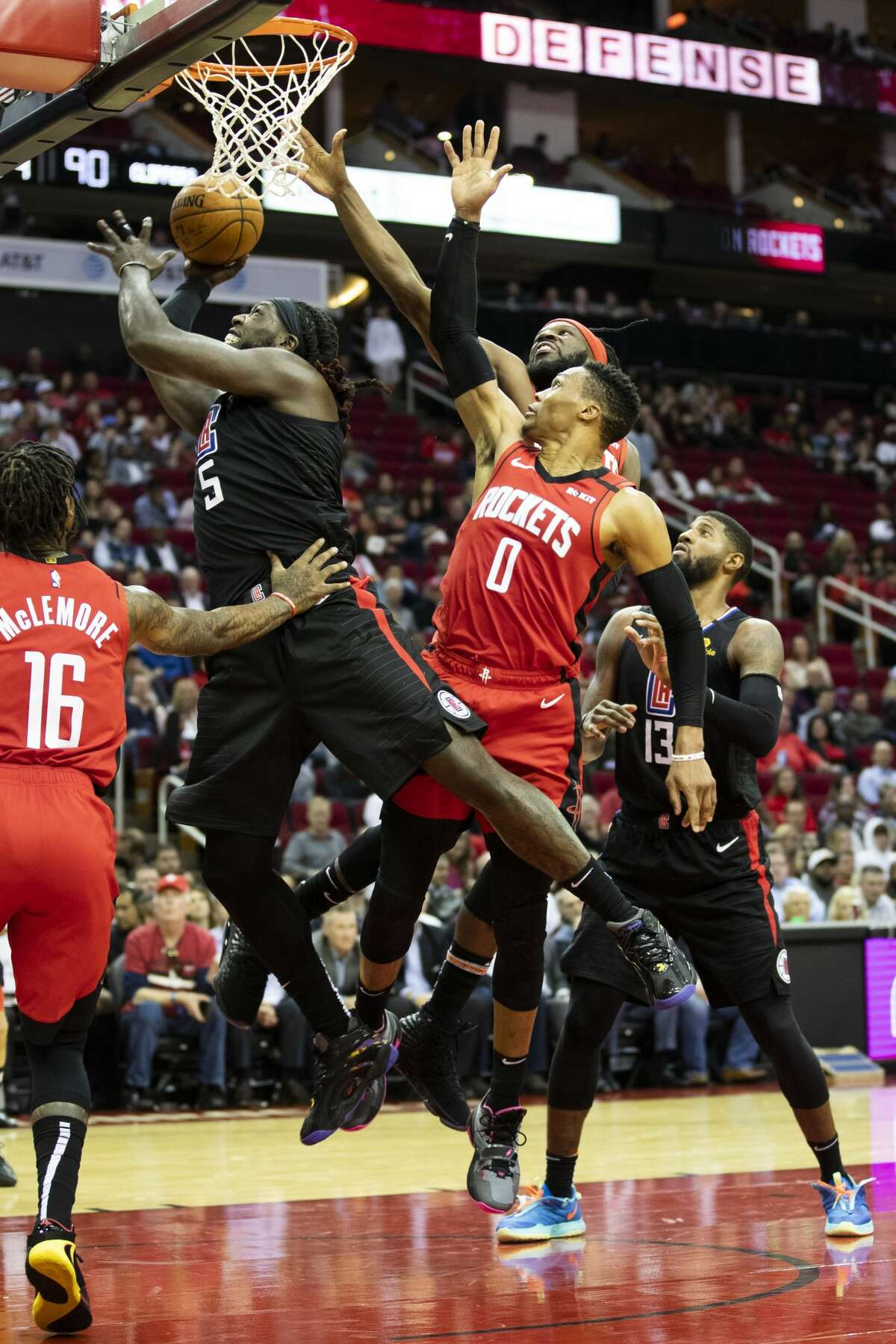 LA Clippers forward Montrezl Harrell (5) lay up successfully under the pressure of Houston Rockets guard Ben McLemore (16) and guard Russell Westbrook (0) during the second half of the game at the Toyota Center on Thursday, March 5, 2020, in Houston. The LA Clippers won 120-105.