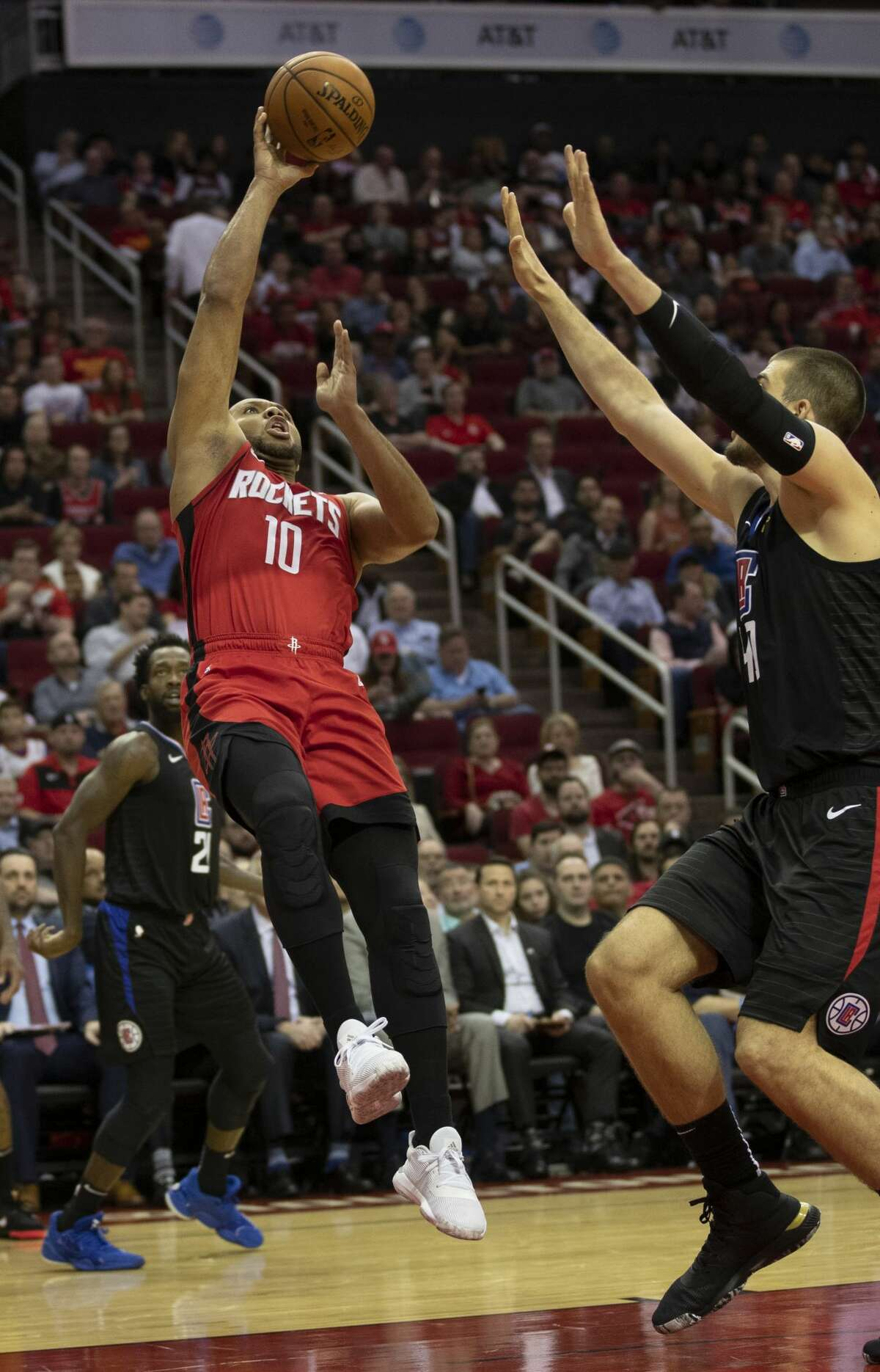 Houston Rockets guard Eric Gordon (10) throws the ball scoring against LA Clippers center Ivica Zubac (40) at the Toyota Center on Thursday, March 5, 2020, in Houston.