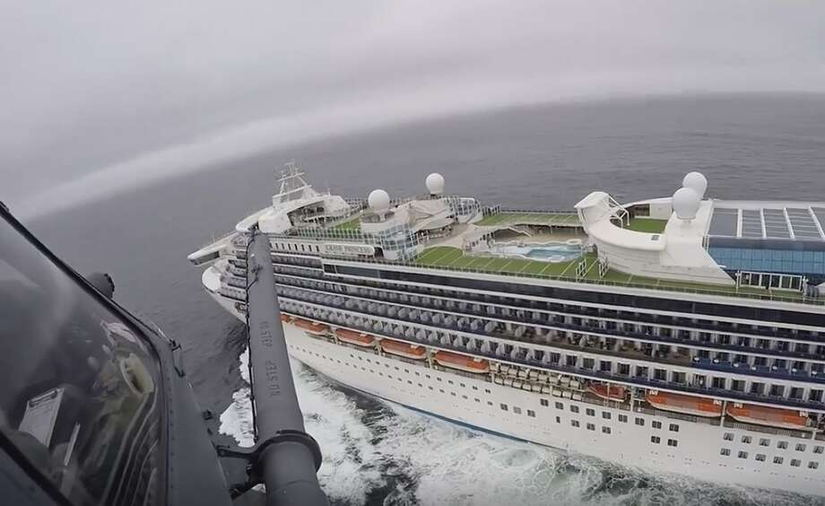 In this image from video, provided by the California National Guard, a helicopter carrying airmen with the 129th Rescue Wing flies over the Grand Princess cruise ship off the coast of California Thursday, March 5, 2020. Photo: Associated Press