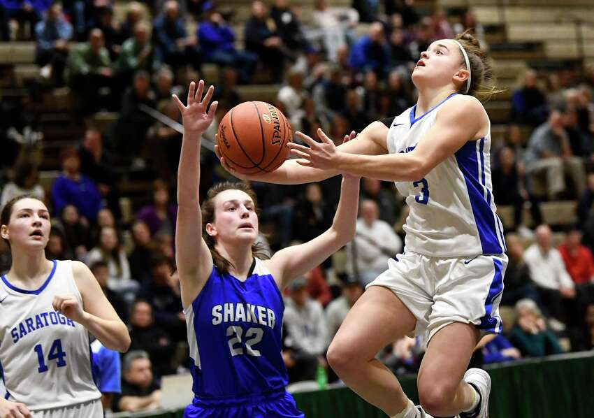Saratoga's Dolly Cairns (3) scores against Shaker's Reilly McCarthy (22) during a girls' Section II Class AA high school semifinal basketball game Thursday, March 5, 2020 in Troy, N.Y. (Hans Pennink / Special to the Times Union) ORG XMIT: 030620_hsbb_girls1_HP118
