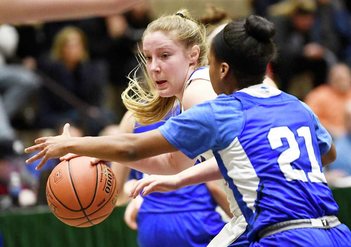Saratoga's Abby Ray (4) moves the ball against Shaker's Kj Gordon (21) during a girls' Section II Class AA high school semifinal basketball game Thursday, March 5, 2020 in Troy, N.Y. (Hans Pennink / Special to the Times Union) ORG XMIT: 030620_hsbb_girls1_HP122