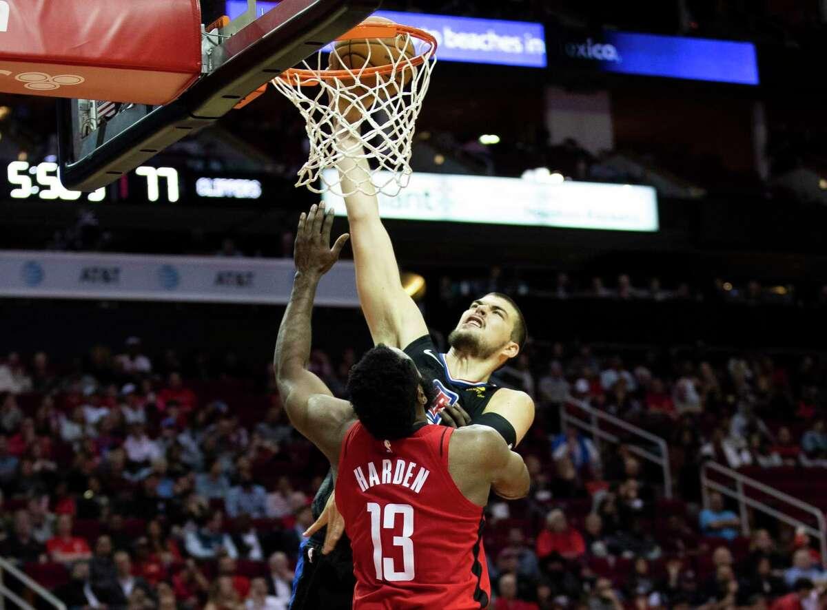 Clippers center Ivica Zubac renders Rockets guard James Harden defenseless on a third-quarter dunk Thursday night at Toyota Center.