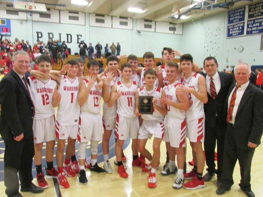 Wamogo won its fourth straight Berkshire League Boys Basketball Tournament championship Friday night at Shepaug High School. Photo: Peter Wallace/For Hearst Connecticut Media