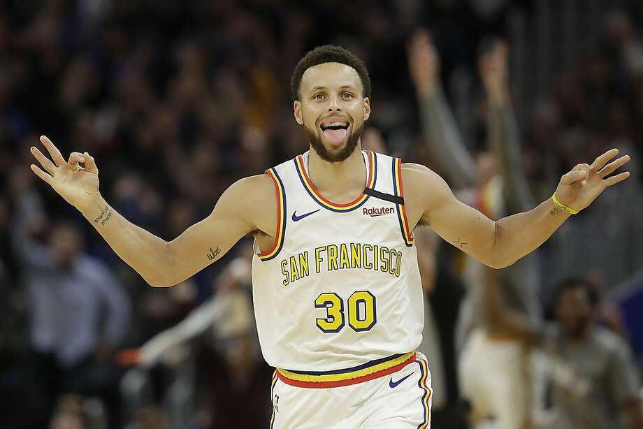 Golden State Warriors guard Stephen Curry (30) reacts after shooting a 3-point basket against the Toronto Raptors during the first half of an NBA basketball game in San Francisco, Thursday, March 5, 2020. (AP Photo/Jeff Chiu) Photo: Jeff Chiu / Associated Press