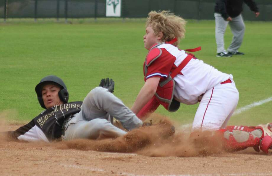 FBCA freshman catcher Ryan Towe applies the tag on an Alief Hastings runner attempting to score in the fourth inning Thursday. Photo: Robert Avery