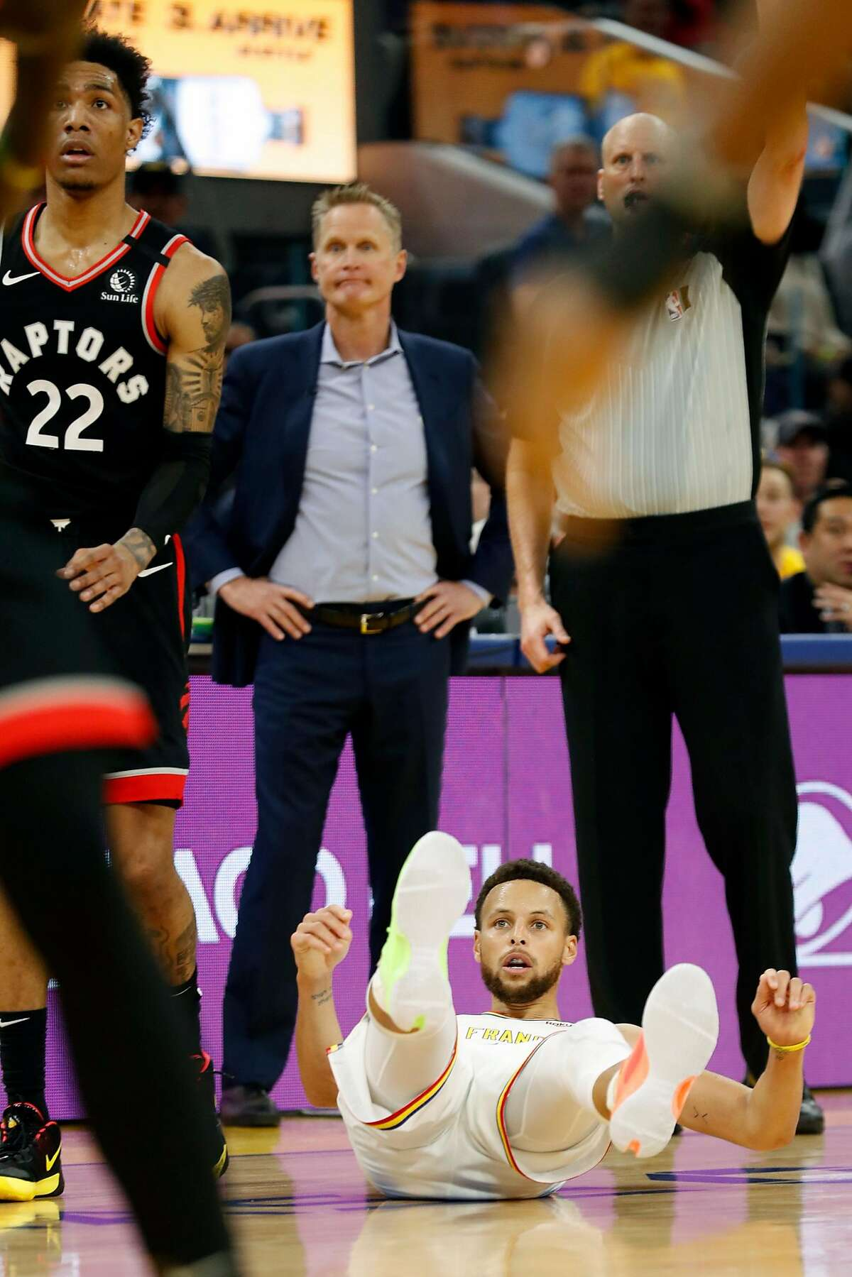 Golden State Warriors' Stephen Curry watches a missed shot from his back against Toronto Raptors' Patrick McCaw during NBA game at Chase Center in San Francisco, Calif., on Thursday, March 5, 2020.