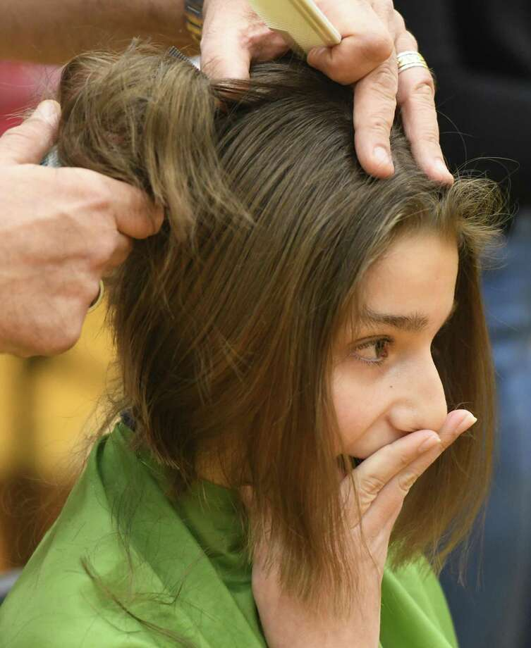 "Seventh-grader Faith Franceschini, the top event fundraiser, gets her head shaved at the ""Mane Event"" head-shaving fundraiser to benefit St. Baldrick's Foundation at Western Middle School in Greenwich, Conn. Thursday, March 5, 2020. Participants shaved their heads and trimmed their ponytails (at least eight inches) at the event to raise more than $13,000 for St. Baldrick's Foundation, which funds childhood cancer research. In 2019, the foundation raised $35,930,451 through its events held all across the country. Photo: Tyler Sizemore / Hearst Connecticut Media / Greenwich Time"