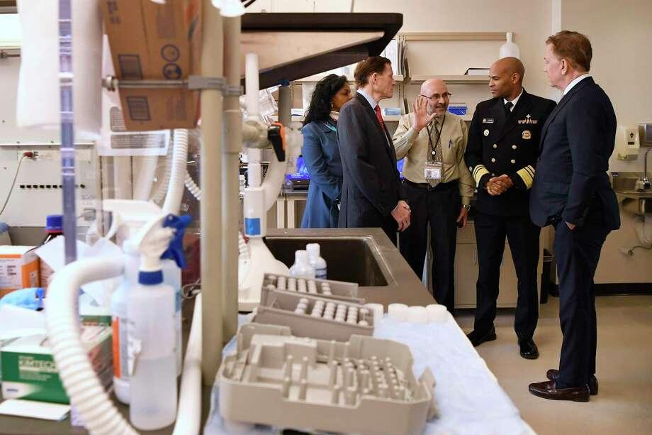 Laboratory Director Jafar H. Razeq, center, gives a tour of the Connecticut State Public Health Laboratory, to U.S. Surgeon General Vice Admiral Jerome M. Adams, second from right, Gov. Ned Lamont, right, and U.S. Sent Richard Blumenthal and Public Health Commissioner Renée D. Coleman Mitchell, left, Monday, March 2, 2020, in Rocky Hill, Conn. (AP Photo/Jessica Hill) Photo: Jessica Hill / Associated Press / Copyright 2020 The Associated Press. All rights reserved.