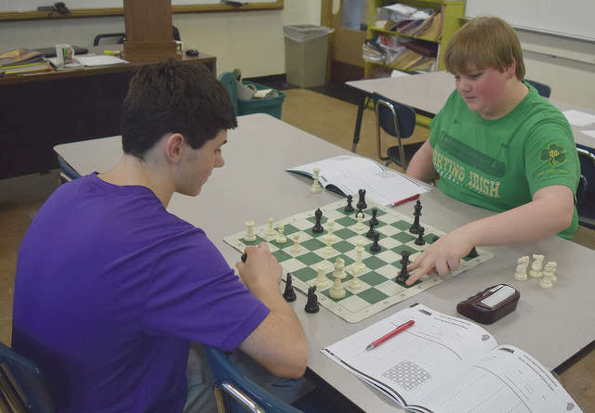 Franklin Junior High School student Mitchell Tapscott (right) makes his move during a game of chess with fellow Franklin eighth-grader Isaac Long. Tapscott won first place Saturday in the Illinois Elementary School Association's state chess tournament.