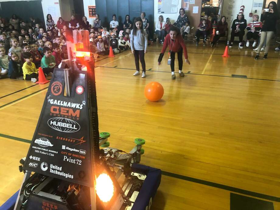 Mohegan School students got to play catch with the Shelton High robotics team's latest creation during a special assembly Monday. Photo: Brian Gioiele / Hearst Connecticut Media / Connecticut Post