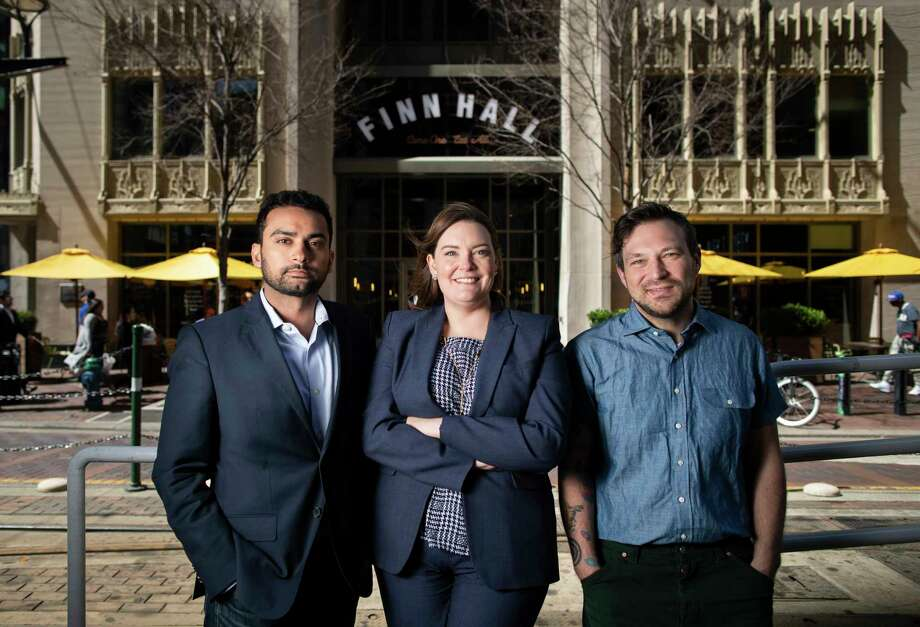 Hunain Dada, of Lionstone Investments (director of real estate portfolio management,) Miranda Cartwright with Midway (senior manager for property management,) and David Buehrer are bringing new management and ideas to the downtown food hall, Finn Hall. Buehrer is the project's new culinary director. Photo: Marie D. De Jesús, Staff Photographer / © 2020 Houston Chronicle