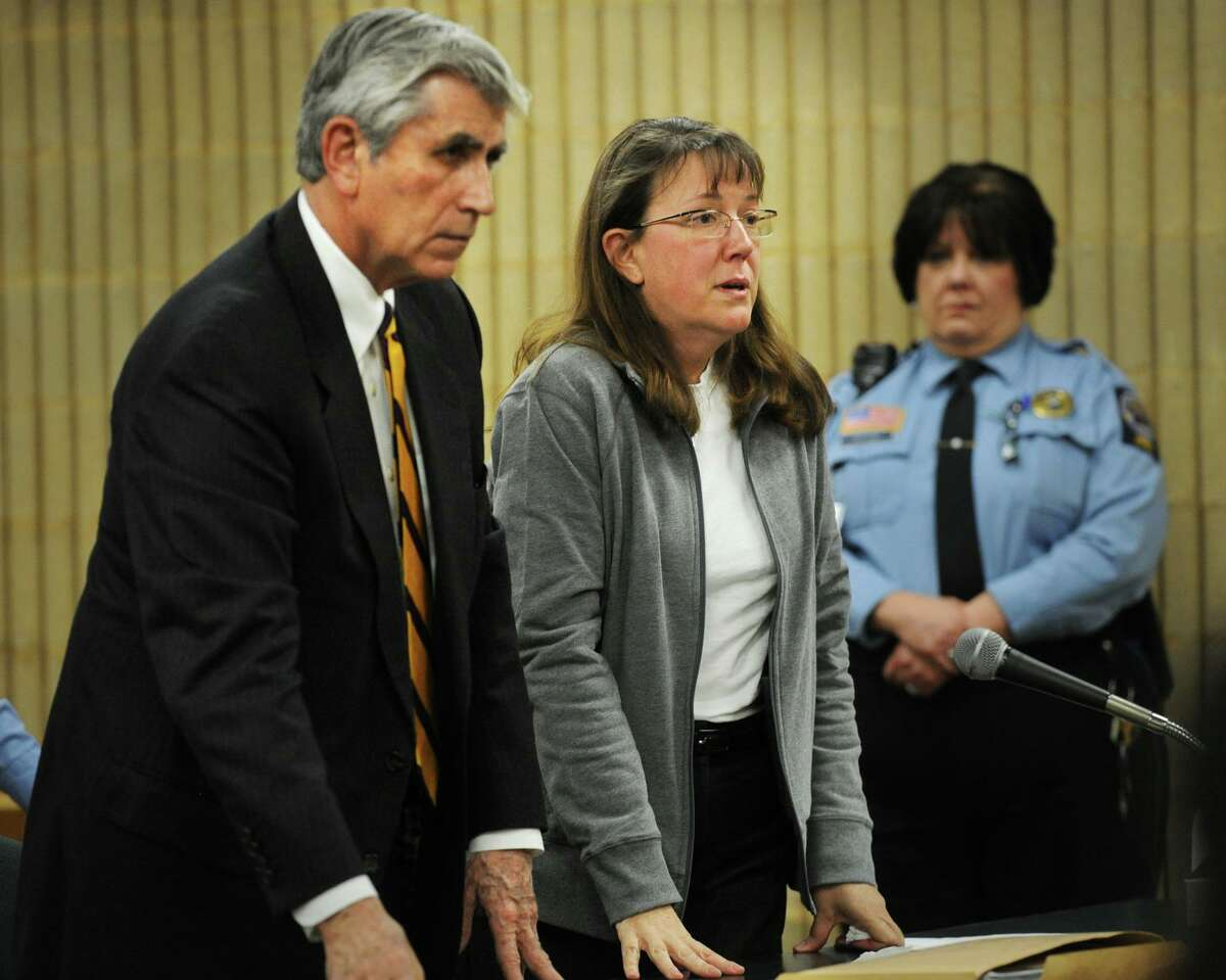 Sharon Scanlon, former assistant finance director for Shelton, stands with her lawyer, William Dow, to hear her sentence at Milford Superior Court in Milford, Conn. on Thursday, January 30, 2014. Scanlon received a 12-year sentence, suspended after 4.5 years, on larceny and forgery charges.