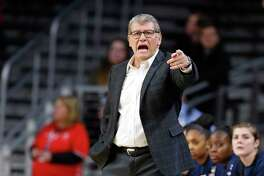 Connecticut coach Geno Auriemma instructs the team during a game against Cincinnati in February,