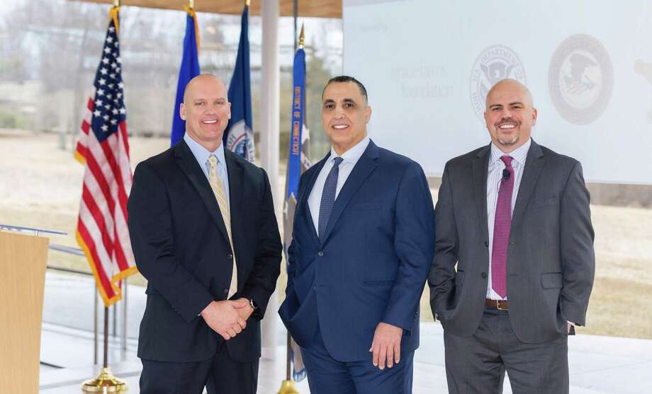 "Bradley Beeler, special agent and polygraph examiner, with the U.S. Secret Service; Rod Khattabi, chief accountability officer and justice initiative director with the Grace Farms Foundation, and Greg Boucher, special agent and polygraph examiner with U.S. Homeland Security Investigations stand for a photo at Grace Farms in New Canaan. The Grace Farm Foundation recently convened a major symposium titled ""Partnerships to Combat Modern Slavery."" Photo: Kyle Norton / Contributed Photo"