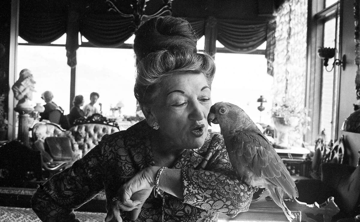 Sally Stanford with her parrot Loretta, October 18, 1965
