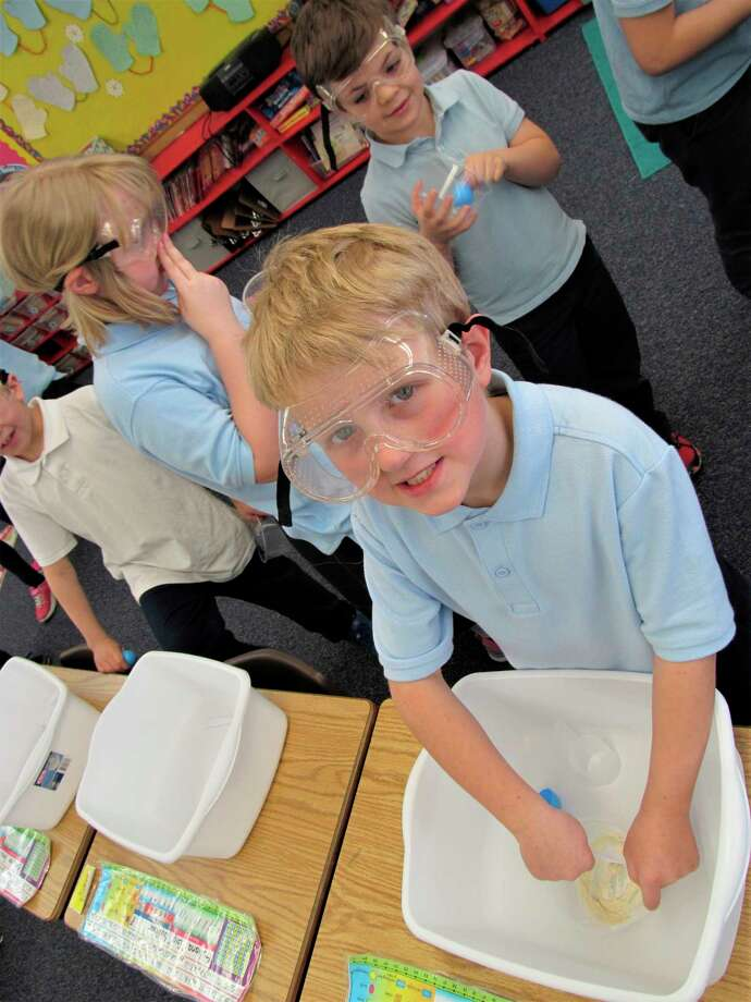 Second graders James Wiggins (front) and Sam Green enjoy their STEM engineering design activity at Blessed Sacrament School. (Photo provided)