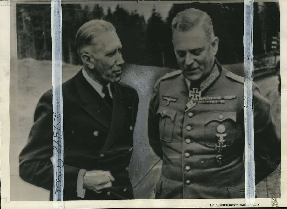 """Von Papen, Franz. Colonel Baron Franz von Papen, who was captured with his family by the American in the Ruhr offensive, is shown at the left in the picture chatting with General Field Marshal Von Keitel in Berlin, during the """"better"""" days of German warfare."""