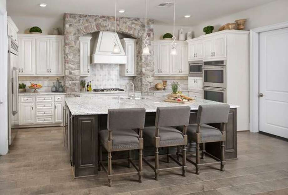 At Caldwell Homes, kitchens offer modern appliances, islands, and plenty of cabinet space.
