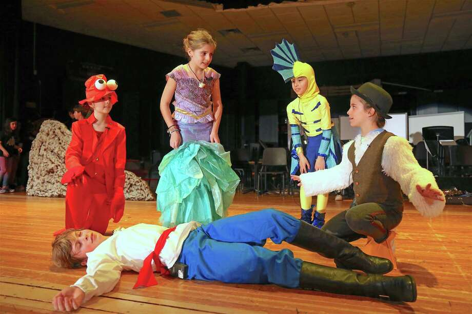 """Performing a scene are, from left, Nate Maurillo, 10, Nadia Stubbs, 9, Sally Nathan, 10, Isabella Mariani, 9, and Delilah Berniker, 9, all of Westport, at the Saugatuck Elementary School Theater Club's rehearsal for """"The Little Mermaid"""" on March 4, 2020, in Westport. Photo: Jarret Liotta / For Hearst Connecticut Media / Jarret Liotta / ©Jarret Liotta 2020"""
