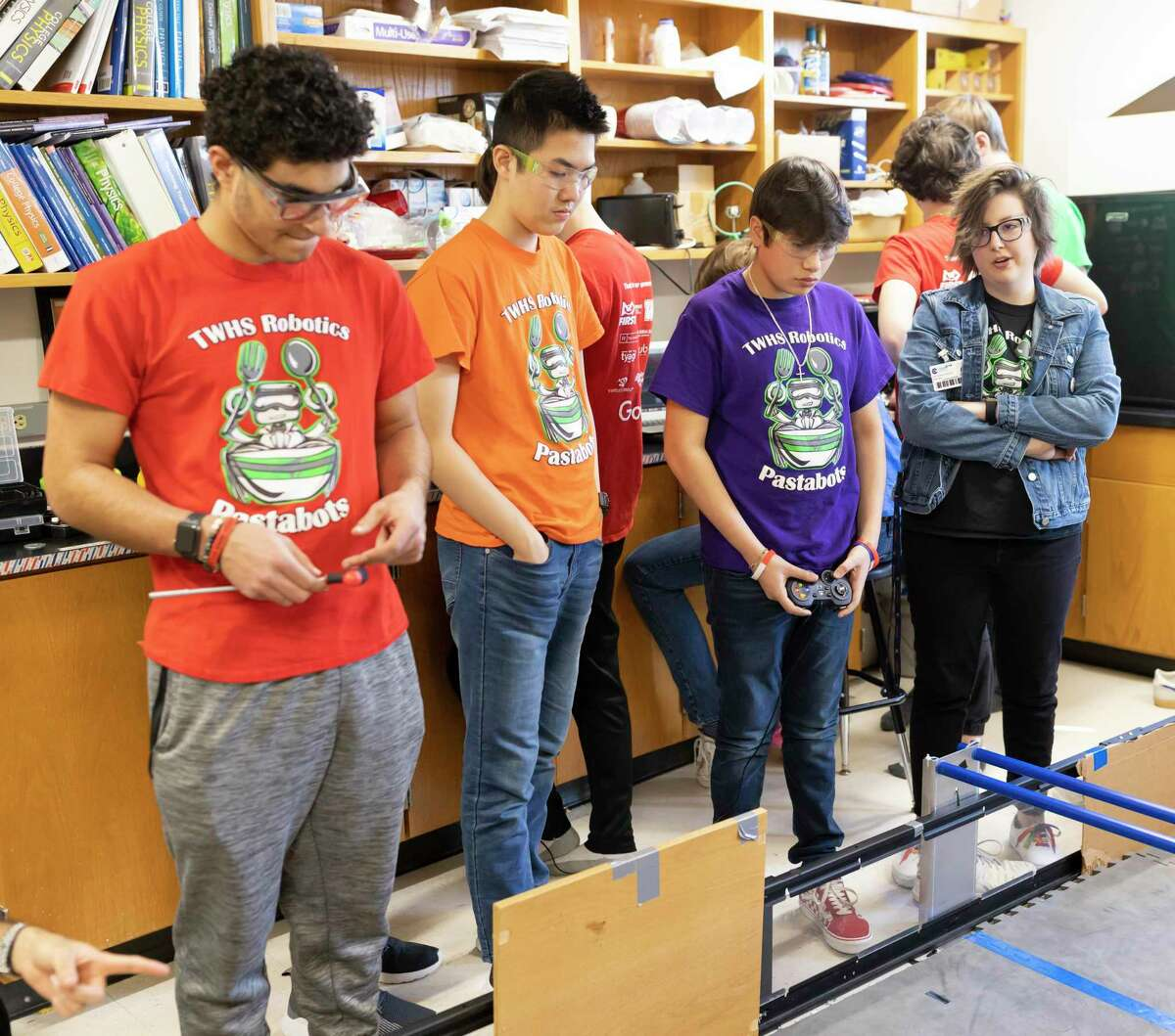 From left to right, Diego Zarur, Stone Meng, Mateo Martinez and Lauren Hamel practice driving their robot at The Woodlands High School, Thursday, Feb. 27, 2020. The Woodlands High School will be competing in state finals in Dallas on March 14, 2020.