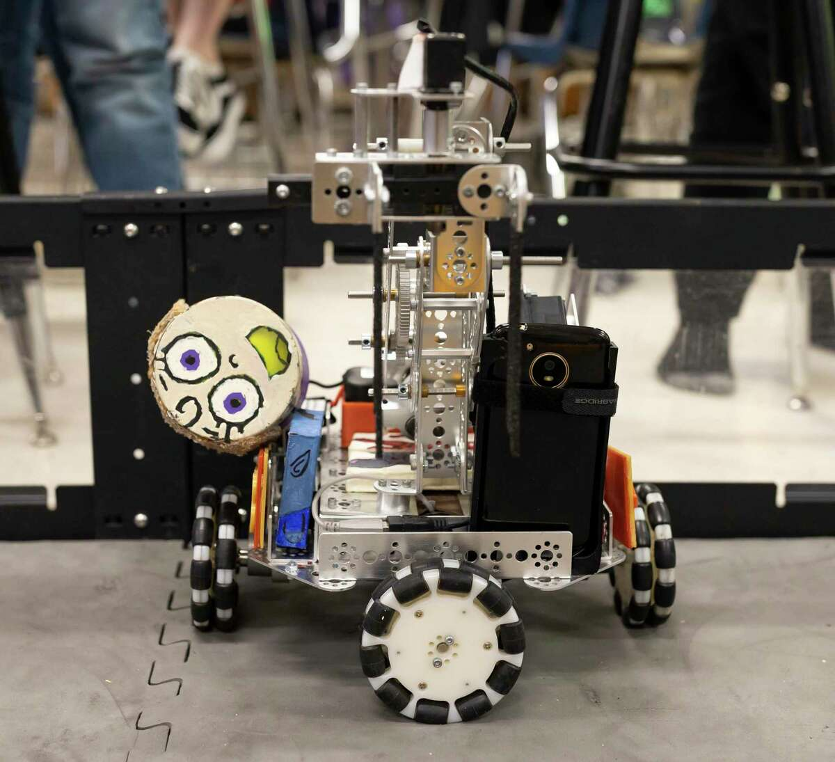 Caney Creek High School drives their robot at The Woodlands High School in preparation for state competition, Wednesday, March 4, 2020. The Woodlands High School and Caney Creek High School hope to form an alliance before state.