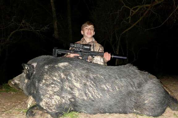 On a recent hunting trip with his dad, Fulshear teenager Scout Neece took down this nearly 400-pound feral hog.