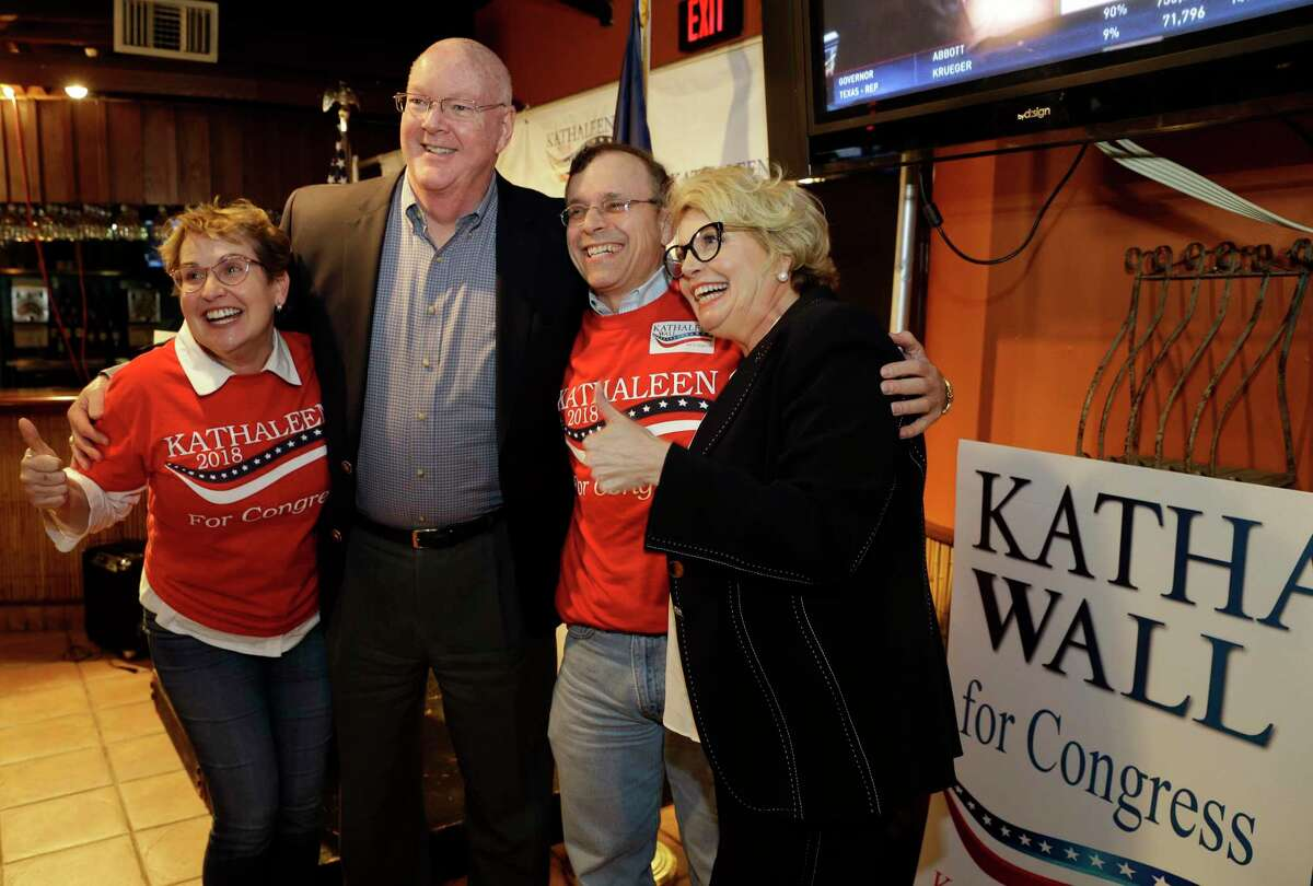 Kathaleen Wall (right), republican candidate to replace Ted Poe in Congress, poses for photos with supporters at her watch party held at the Adobe Cafe Tuesday, Mar. 6, 2018 in Houston, TX. (Michael Wyke / For the Chronicle)