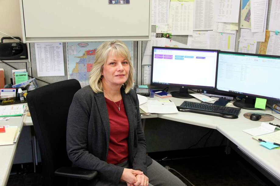 Susan Krozek at her desk at the Huron County Road Commission Office. (Robert Creenan/Huron Daily Tribune)