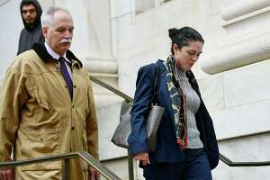 State's Attorney Justina Moore appears at  Superior Court in New Haven with her attorney Eugene Riccio Jan. 3, 2020.