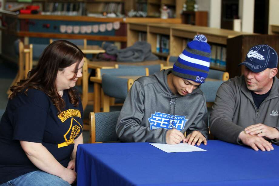 North Huron senior De'Andre Morris signed his letter of intent to run cross country at Lawrence Technical University on Friday, March 6. Photo: Eric Rutter/Huron Daily Tribune