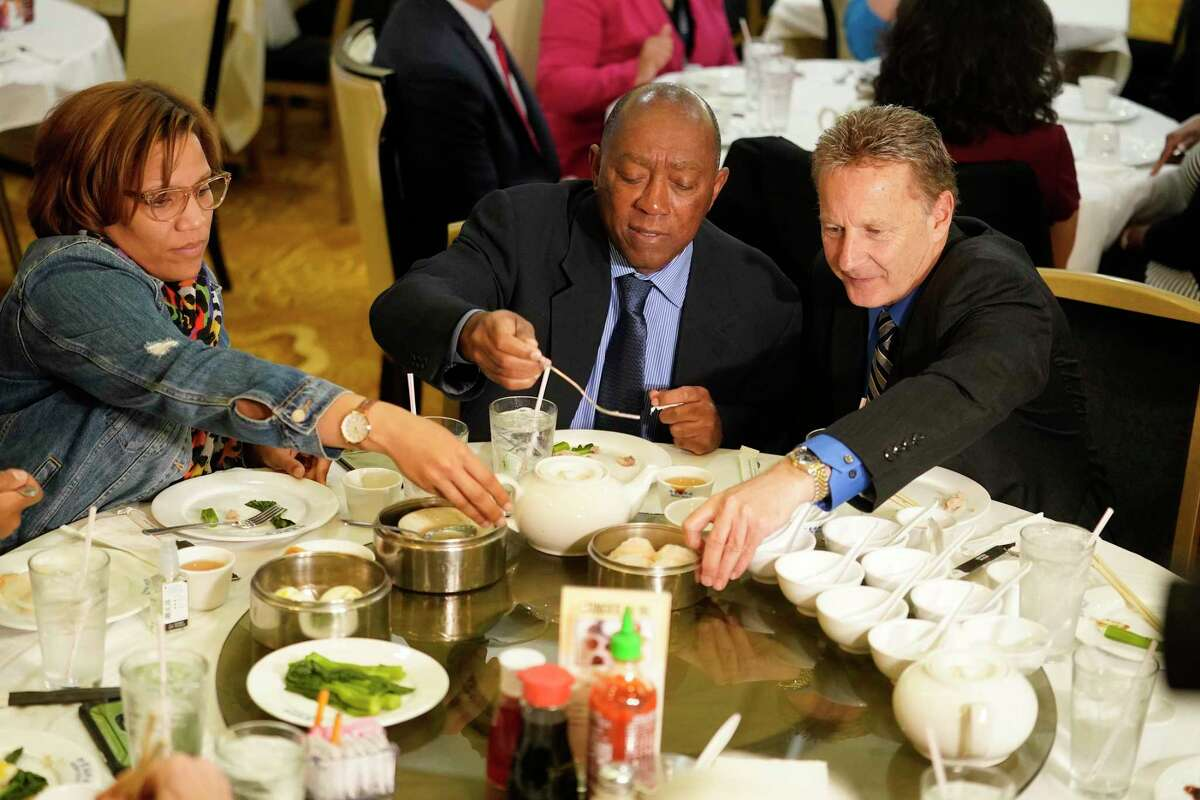 Tiffany Thomas, City Council member, left, Mayor Sylvester Turner, and George Buenik, Public Safety director, right, eat lunch at Ocean Palace Restaurant, 11215 Bellaire Blvd., Thursday, March 5, 2020, in Houston. Mayor Sylvester Turner gathered with a couple dozen staff members and city officials for lunch at Ocean Palace in Asiatown in a bid to alleviate concerns and tamp down on rumors about COVID-19.
