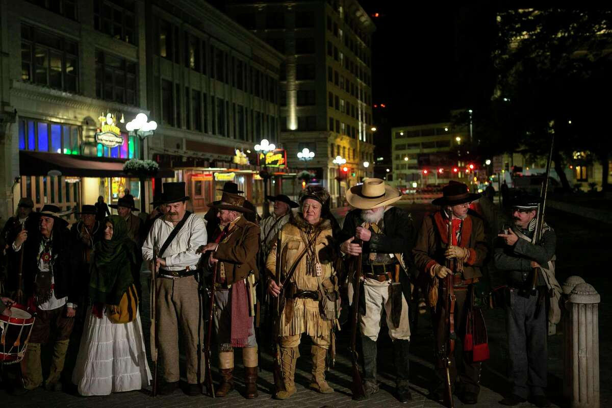 """Reenactors line up across Alamo Street before the """"Dawn at the Alamo"""" ceremony commemorating the 184th anniversary of the Battle of the Alamo at the Alamo in San Antonio, Texas, March 6, 2020. The early morning battle of March 6, 1836, claiming the lives of was solemnly remembered during the popular annual event."""