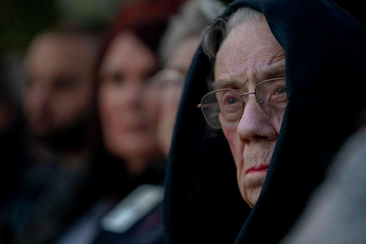 """Caroline Clifton, a 3rd great-granddaughter of David Crockett, looks towards the Alamo during the """"Dawn at the Alamo"""" ceremony commemorating the 184th anniversary of the Battle of the Alamo in San Antonio, Texas, March 6, 2020."""