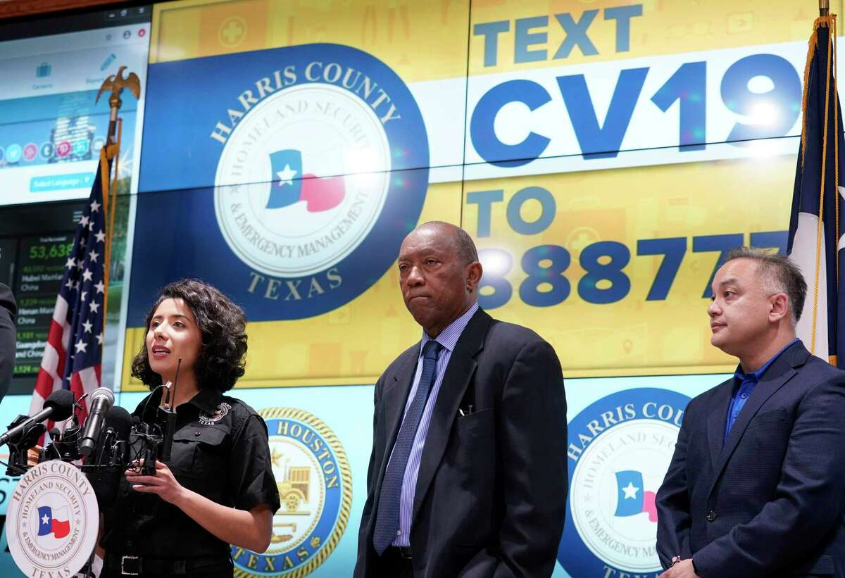 Harris County Judge Lina Hidalgo, left, speaks as Houston Mayor Sylvester Turner, and Dr. Umair Shah, executive director of Harris County Public Health, right, listen about the first two cases of coronavirus in Harris County during media conference at Houston Transtar Thursday, March 5, 2020 in Houston. One man and one woman in the unincorporated area of northwest Harris County tested positive for COVID-19, according to county officials. Both patients, and the man in Fort Bend county that tested positive for COVID-19, had traveled together to Egypt.