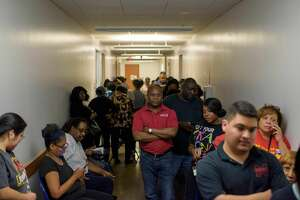 Voters line up at a polling station to cast their ballots during the presidential primary in Houston, Texas on Super Tuesday, March 3, 2020. (Photo by Mark Felix / AFP) (Photo by MARK FELIX/AFP via Getty Images)