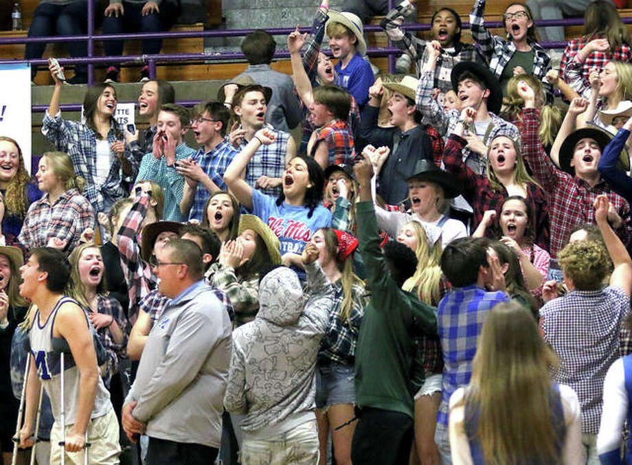 Marquette Catholic's student section cheers on the Explorers in the second half in a semifinal at the Shelbyville Class 2A Sectional.