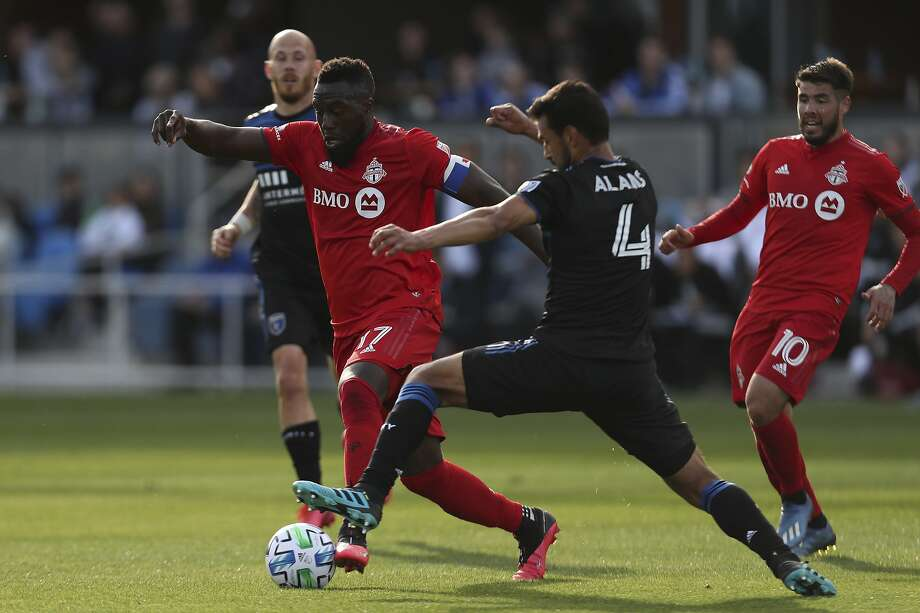 Toronto FC's Jozy Altidore (17) battles for the ball with San Jose Earthquakes' Oswaldo Alanis (4) during the second half on an MLS soccer game in San Jose, Calif., Saturday, Feb. 29, 2020. (AP Photo/Jed Jacobsohn) Photo: Jed Jacobsohn / Associated Press
