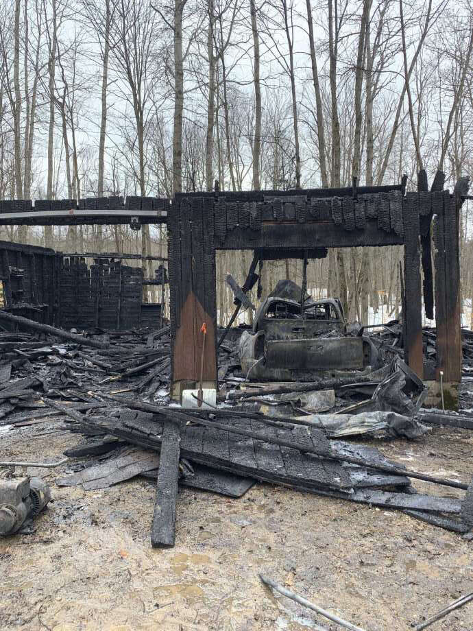 A garage in the 16000 block of 135th Avenue, in Colfax Township, was deemed a total loss following a Friday morning fire. Photo: Pioneer Photo/Cathie Crew