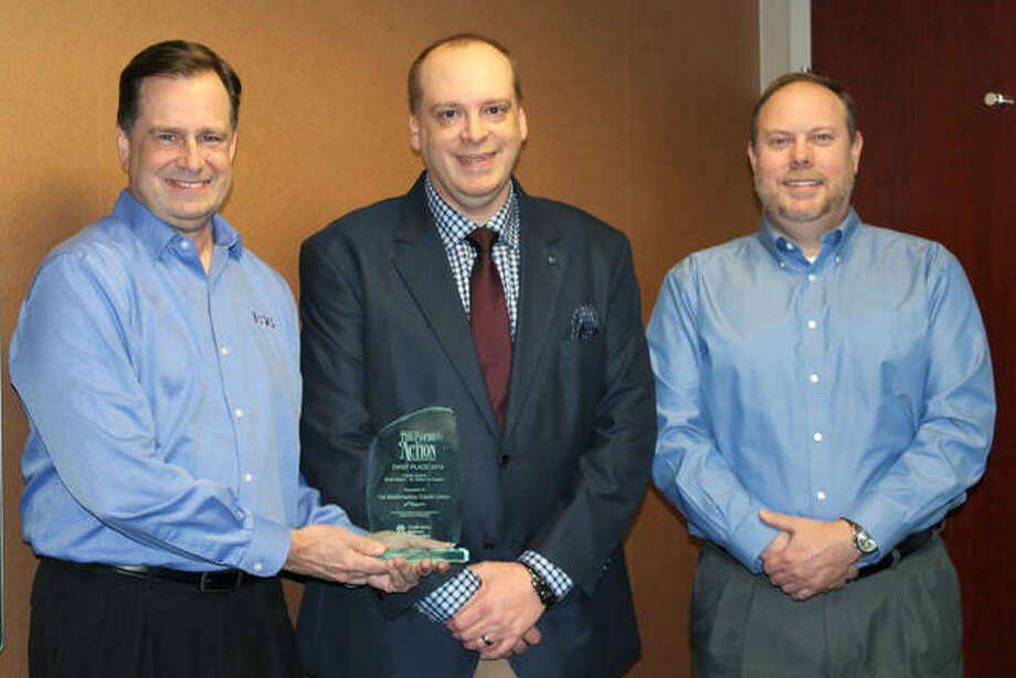 James Cherry, CIO, and Shane Powell, Director of IT, at 1st MidAmerica Credit Union, receive an award from Kevin Shaw of the Illinois Credit Union League.