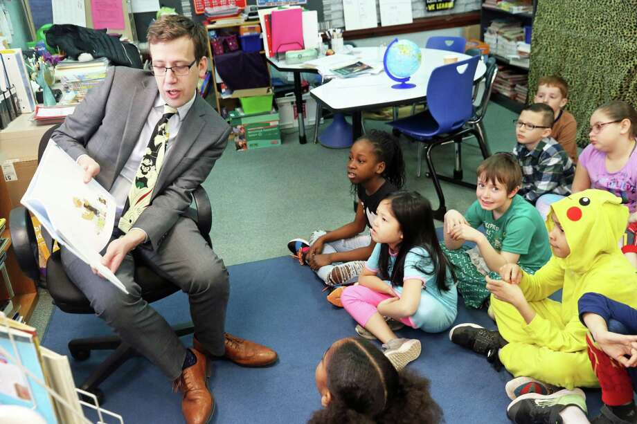 State Sen. Matt Lesser, D-Middletown, reads to students at MacDonough Elementary School in Middletown for National Read Across America Day. Photo: Contributed Photo